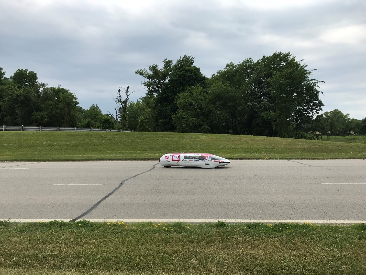 MSOE Supermileage vehicle on the track at the Eaton Proving Grounds